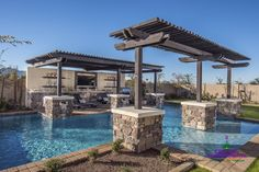 Backyard pool beach entry with arbors and water feature | Yelp