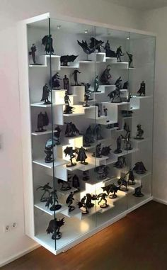 Great way to display figures - Use wall shelves from ikea, staggered heights, with small lights throughout