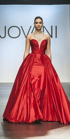 Gorgeous strapless gown with deep plunging sweetheart neckline, ruched bodice, and featuring an open-faced ballgown skirt
