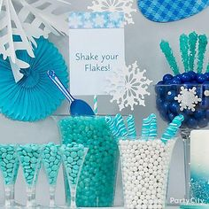 Walk through a winter candy-land! Fill clear candy containers with Robin's Egg Blue & White Sixlets, plus Twisty Pops to create this display!