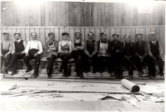 """Throw Back Thursday!s Arena - Laying the Oak Floor, crew who lay the oak floor in the arena pose for a picture. A sign hanging on the wall at the right of the picture edge states """"No Smoking or Spitting Allowed. Hanging Signs, Your Image, Thursday, Smoking, Floor, Poses, History, Concert, Gallery"""