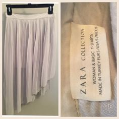 Zara Silk Pleated Skirt Zara Collection Silk Pleated Skirt in a creamy light grey. Size Small. Please send reasonable offers through the offer button! Zara Skirts High Low