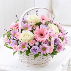 Mothers Day Basket - This classic basket arrangement of gorgeous fresh #flowers is a great choice for Mother's Day as it arrives ready to display straight way. There is lots of colour and detail here for her to admire, as well as two luxurious white roses at the heart of this pretty display. #MothersDay £32.99 - Standard £42.99 - Superior (As shown in image)