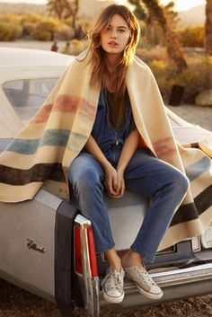 The simple placement of the blanket over her shoulders is genius. Imagine the picture without it...boring.