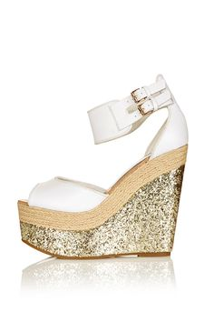 glittery espadrille wedges **I bet I could DIY this w/those ugly cork heeled wedges!)