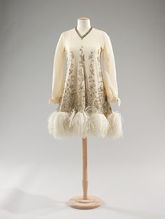 Cocktail dress Valentino  (Italian, born 1932) Date: ca. 1970 Culture: Italian Medium: silk, rhinestones, feathers Dimensions: Length at CB: 35 in. (88.9 cm) Credit Line: Brooklyn Museum Costume Collection at The Metropolitan Museum of Art, Gift of the Brooklyn Museum, 2009; Gift of Vera Aryeh, 1993