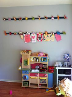 Use lumber and clothespins to make this super easy kids' art display. A great way to showcase your little one's art as they get older!