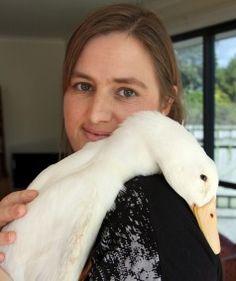 Adele Gichard cuddles Abner the duck.