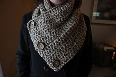 """This is a free pattern for a buttoned wrap scarf. Finished sizes will vary slightly based on stitch tightness, but the basic gauge for this scarf: three rows of 7 double crochets should produce a 4"""" x 3.5"""" rectangle. Each scarf uses two skeins, with close to half a skein leftover."""