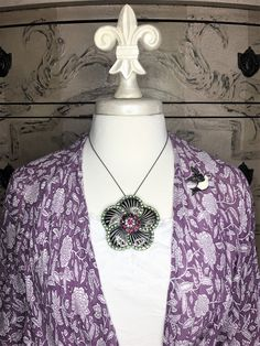 Flower Power Jewelry...Statement necklaces and brooches...aged metals and sparkling crystals with a unique back. Bling it on and decorate your life with Evelyn Hope