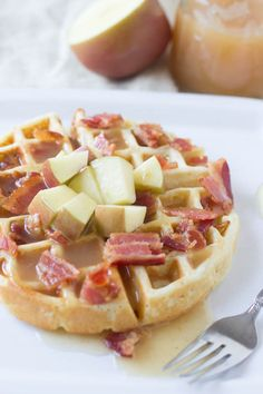 Fluffy waffles filled with sweet apples and crisp bacon are already delicious, but top it with the best apple cider syrup and we are hooked! ohsweetbasil.com-3