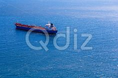 Qdiz Stock Photos | Empty container cargo ship,  #blue #boat #cargo #commerce #commercial #container #deep #delivery #empty #freight #industrial #industry #international #logistics #marine #moving #nautical #ocean #offshore #open #sea #ship #shipping #tanker #transport #transportation #vessel #water #waterline