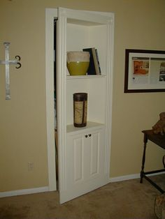 Hidden Bookcase Door - great idea for doors that are near living areas