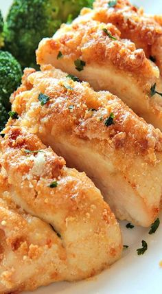 Chicken breasts, garlic, parmesan and bread crumbs baked in the oven with a drizzle of mayonnaise! What's not to love?!