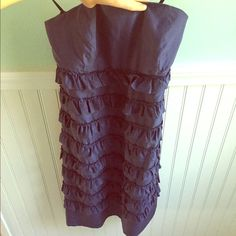 GAP navy strapless dress Navy strapless dress, GAP, worn maybe 3 times, excellent condition. Adorable ruffles all around, hidden side zipper with hook and eye at the top. Boning on the sides (shown in photo). Shell 55% silk, 45% cotton, lining 100% polyester. GAP Dresses Strapless