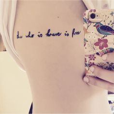 'She who is brave is free' tattoo