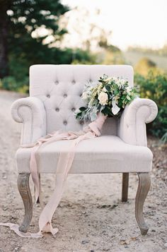 Vintage chair and a bouquet wrapped in flowing ribbon: http://www.stylemepretty.com/2014/02/10/rustic-chic-australian-shoot-at-gurragawee/   Photography: Feather & Stone - http://featherandstone.com.au/