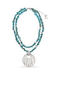 Erica Lyons Silver-Toned Go West Circle Pendant Necklace