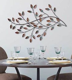 24cef6e5c2 You'll love the mix of nature and modern design in this charming Stratton  Home Decor blowing leaves wall decor.