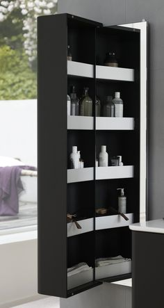 Tall cabinet Stylish shelves with a front edge. The spacious aluminium shelves offer you a great overview with plenty of room. High full-length Dansani Curvo mirror as back wall. Shower Enclosure, Bathroom Furniture, Bathroom Medicine Cabinet, Shelves, Mirror, Lighting, Stylish, Wall, Home Decor