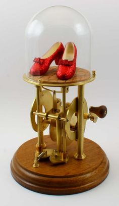 added by Brandi  The Ruby Slippers Automaton by Automaton Man   Automata were extremely popular with cabinet owners. In one case, an automaton wrote out an entire poem. This sweet one, inspired by the Wizard of Oz, clicks its heels together three times and reminds you that there's no place like home.