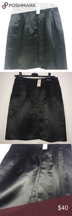 NEW! Ann Taylor Satin Black Skirt Size 2 NEW! Ann Taylor Satin Black Skirt, Size 2, Knee Length, 2 pockets, 1 pleat in the center. Ann Taylor Skirts