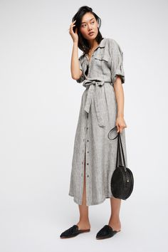 Cayman Dress   Handmade lightweight midi dress in an effortless silhouette and stripe pattern.  * Button closures down the front * Adjustable waist tie * Front bust pockets * Cuff sleeves easily with a button closure * Elastic waistband in back