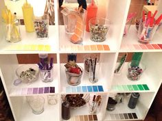 Shelves of art materials arranged by colour. Paint chips act as labels. Make art materials so appealing! (Reggio Emilia: Color - Fairy Dust Teaching)