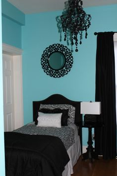 girls rooms - Sherwin Williams belize, black and white, auqa, teal, turquoise, fabric headboard, chandelier, pedestal table, black lamp, black drapes, mirror, floral, white, black, throw pillows, teens, girls room. bedroom. Designed using Tiffany & Co. colours...