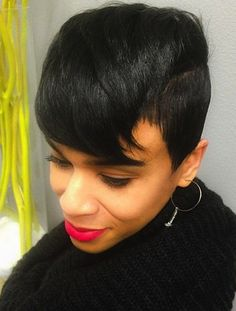 Short Hair Cropped on sides longer on top.  Nice look.  Short hairstyles for black women will have another great year this year.
