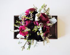 deep pink and burgundy ranunculus, dusty miller and filler