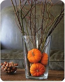 Fall decor with branches and pumpkins