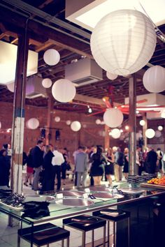 white paper lanterns for reception décor - thereddirtbride.com - see more of this wedding here