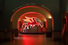 "Pegasus inside the Old Red Museum in Dallas, Texas;  on a sign next to it:  ""Pegasus – 1939  For 50 years this Pegasus sat atop a Mobil gas station...in east Dallas where it was lighted and rotated. Before that, it was on display in the 1939 World's Fair in New York. ..."""