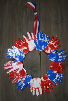 Kids' Handprint Wreath cut out large stars in red white and blue -have on wall board -have each person at party sign a star with a note for /about day!