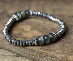 LABRADORITE STRETCH BRACELET This listing is for one stunning labradorite and hematite stack bracelet. This beautiful stretch bracelet has so much shimmer and will look amazing layered with other bracelets. To view the other bracelets in this bracelet stack, you can click on the links below. https://www.etsy.com/listing/250393484/boho-bracelets-pearl-bracelets-hematite?ref=shop_home_active_2 https://www.etsy.com/listing/250391360/stret...