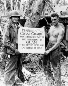"Marines Thank Coast Guard, Guam, 1944  Original Caption: ""Marine PFC William A. McCoy and PFC Ralph L. Plunkett hold a sign saluting USCG forces after the Japanese were defeated at Guam.""  Circa July 1944; CG Photo No. 2709; photographer unknown."