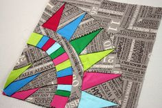 LOVE the typography fabric!!  New York Beauty Quilt Along: Block 5 by sewsweetness, via Flickr