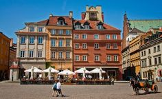 Castle Square, in Old Town, is part of the rich fabric of Warsaw's history. It was rebuilt after being decimated by Nazi troops during World War II. (From: PHOTOS: 26 Awesome (and Affordable!) Alternatives to Pricey Vacation Hot Spots)
