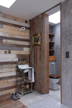 Converted Shed - the reclaimed wood wall is sleek but yet rustic...a perfect compromise for me & K!