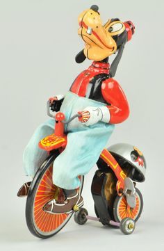 Linemar Goofy on Unicycle. Wind up tin toy from 50s