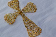 Gold Cross Knitted Wire Ornament or Wall Decoration. $30.00, via Etsy.