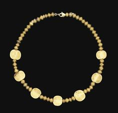 AN ELAMITE GOLD BEAD NECKLACE   CIRCA 3RD-2ND MILLENNIUM B.C.   Comprising fifty-four biconical gold beads, interspersed with seven circular disc beads, strung with modern clasp  15½ in. (39.4 cm.) long