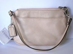 Coach 45651 Shell Soft Leather New With Tags Wristlet. Get the trendiest Clutch of the season! The Coach 45651 Shell Soft Leather New With Tags Wristlet is a top 10 member favorite on Tradesy. Save on yours before they are sold out!