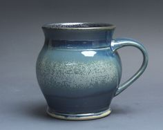 Handcrafted pottery coffee mug, ceramic teacup, stoneware. Glazed inside with a glossy, easy to clean black glaze and outside with glossy, navy blue glaze with a band of lighter blue green and a scattering of silvery microcrystals.  More Blue Parrot cups and mugs: http://www.etsy.com/shop/BlueParrotPots?section_id=6797001  Approx. 4.25x 3. (opening) Will hold approx. 16 ounces of your favorite beverage.  Food, dishwasher, and microwave safe, as is all of my work.