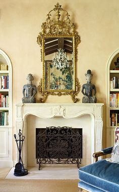 JoBeth Williams' Spanish-Style Home - gilded mirror hangs above 19th century French fireplace