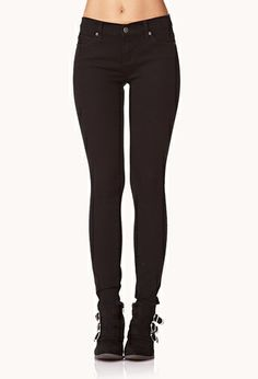 A pair of skinny jeans featuring a five-pocket construction. Zip fly, button waist. Woven. Lightweight.