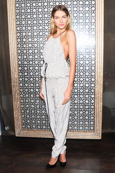 Jessica Hart in a printed jumpsuit and black pointy toed heels
