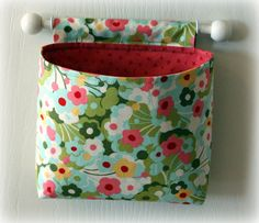 super cute 'fabric buckets' that hang on the wall