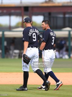 Nick Castellanos #9 and Ian Kinsler #3 of the Detroit Tigers walk across the field during the Spring Training game against the Pittsburgh Pirates at Joker Marchant Stadium on March 12, 2016 in Lakeland, Florida. The Tigers defeated the Pirates 3-0.  Ian Kinsler led off with a single. He went on to steal third and came home on a throwing error to give the Tigers a 1-0.